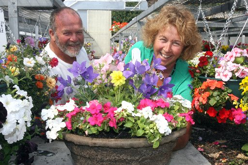 PRIME PETALS: Paul Foster and Marilyn Hunt of Lansdowne Nurseries with hanging baskets and colour bowls prepared for the Ellerslie Flower Show, Christchurch, next month.