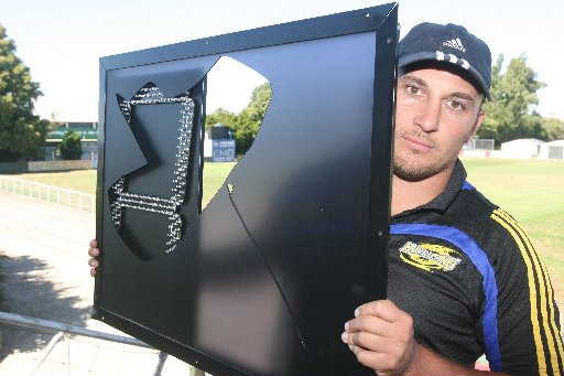 ANNOYED: Stacey Grant, Wairarapa-Bush Rugby Union rugby development officer, and parts of the electronic scoreboard which was smashed by vandals on Sunday.