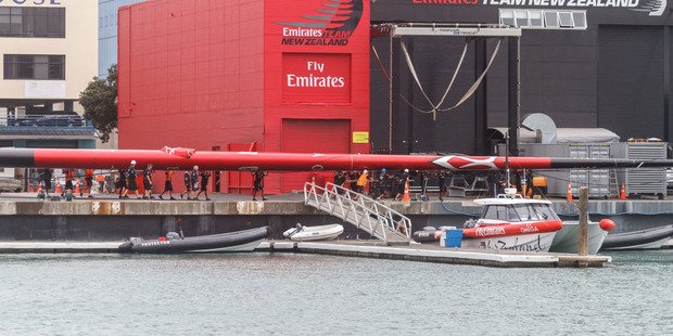 Loading It is believed the wing clipped the side of the main building of Emirates Team New Zealand's base. Photo / Rob Webb