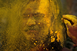 An Indian man celebrates the Holi festival in Gauhati, India. Photo / AP