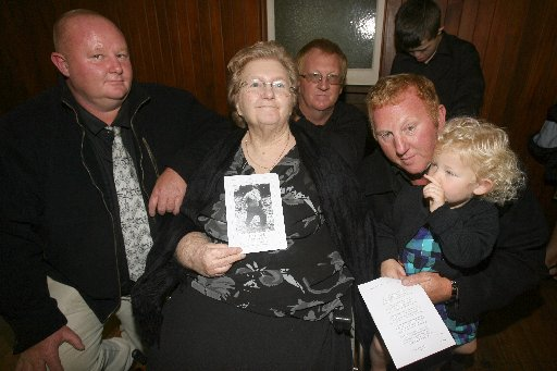 FAMILY: The three sons of Wairarapa multi-millionaire Florus Bosch surround their mother Winifred Bosch, centre, at a memorial service for their dad in the Anzac Hall in Featherston yesterday. Pictured are Brian Bosch, David Bosch, and Allan Bosch, who is