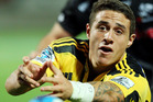 Hurricanes backs Conrad Smith and TJ Perenara (pictured) have both come through training today and will take their place in the Hurricanes starting XV on Saturday. Photo / Getty Images.