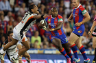 Akuila Uate of the Knights breaks clear of the Tigers defence during the round one match.  Photo / Getty Images