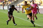 Canes captain Conrad Smith gets among the tries. Photo / Getty Images