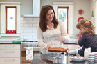 Vanessa Palmer and her daughter in their beautiful kitchen. Photo / Your Home and Garden