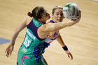Mystics Julie Corletto clashes with the Vixens Karyn Howarth at Trust Stadium, Auckland.  Photo / Richard Robinson