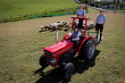 Mt Albert Grammar School students Louisa Roberts, Jessica Munro and Matthew Day in the 8.1ha farm's ewe paddock . Photo / Sarah Ivey