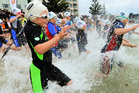 Some children will take part in the 2.8km King of Bays event; others will swim the OceanKids 200m race. Photo / Supplied