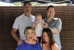 Dougal (top right), Hayley (bottom left), and son Oscar, with his godparents at Oscar's naming ceremony. Photo / Supplied