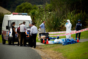 Police at the scene where a woman's body was found at a house on Rodeo Drive, Redvale, Friday. 29 March 2013 New Zealand Herald Photograph by Dean Purcell. NZH 30Mar13 - Police at the lifestyle bl