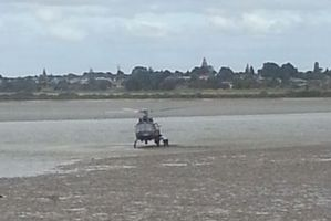 Crew from the police helicopter scooped the boy from the harbour mudflats.