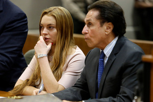 Actress Lindsay Lohan and her attorney Mark Heller listen during a hearing in Los Angeles Superior Court. Photo / AP