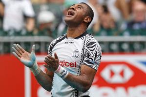 Fiji's Jasa Veremalua celebrates after scoring a try. Photo / AP