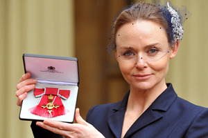 Fashion designer Stella McCartney holds her Officer of the British Empire (OBE) award.Photo / AP