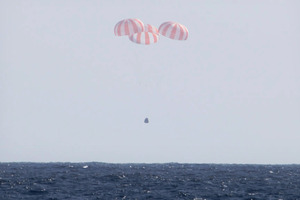 The Dragon capsule uses parachutes to descend to the Pacific Ocean off the coast of Mexico's Baja Peninsula. Photo / AP