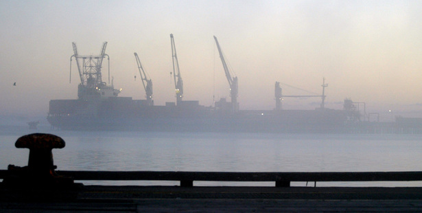A ship docked at Tiwai Point Aluminium smelter on a cold foggy morning in Bluff. Photograph / Dean Purcell