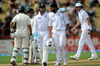 Matt Prior has a calming word with frustrated spinner Monty Panesar. Photo / Dean Purcell