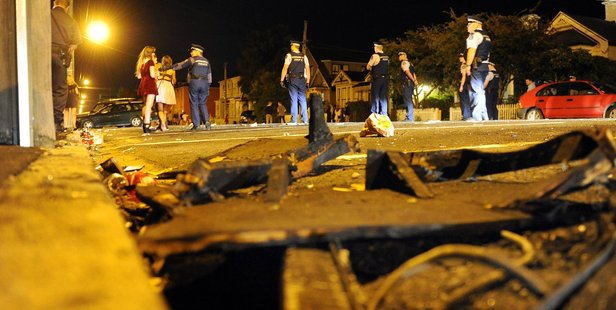 Remains of a furniture fire as Police clear Castle Street of party goers after a large crowd gathered and lit several fires on Saturday night. Photo / Otago Daily Times