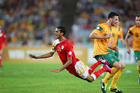 Amad Al Hosni of Oman is brought down after a challenge from Robbie Cornthwaite. Photo / Getty Images
