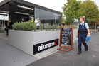 Police at the scene outside Aikmans bar in Merivale, Christchurch. Photo / Martin Hunter