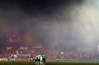 A flare is lit in the crowd during the round 26 six A-League match between the Western Sydney Wanderers and Sydney FC. Photo / Getty Images