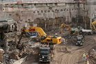Construction workers and equipment excavate the southeastern corner of the World Trade Center site in 2008. Photo / AP