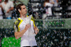 Andy Murray, of Britain, holds the trophy after defeating David Ferrer of Spain in the Sony Open Tennis Tournament. Photo / AP