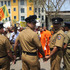 Sri Lankan police officers stand guard as members of a pro-government civic group Ravana Balaya, or Ravan Force, shout slogans outside the Sri Lanka cricket office in Colombo, Sri Lanka. Photo / AP