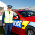 Leo Tooman with the new red police car to raise awareness to road users to slow down. Photo / Christine Cornege