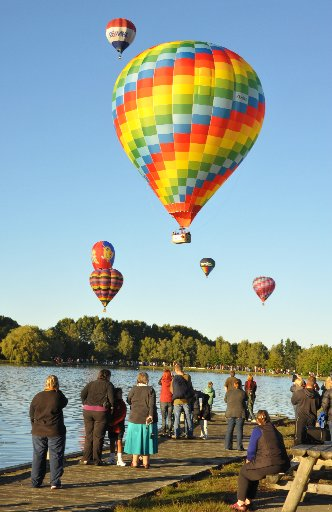 MASSIVE SUCCESS: Festival director Martyn Stacey said large crowds turned out during the four-day ballooning festival. Pictured is the Wairarapa Times-Age Splash `n' Dash event at Henley Lake, Masterton, on Saturday morning.