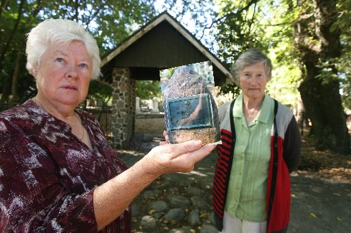 Anne Woodley and Joan Dickens at the Pioneer cemetery lychgate from where the memorial stone and plaque were removed.