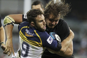 Wimpie van der Walt of the Kings is tackled during the round eight Super Rugby match between the Brumbies and the Kings. Photo / Getty Images.