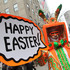 Davey Mitchell, of New York, left, poses for photographs on New York's Fifth Avenue as he takes part in the Easter Parade Sunday. Photo / AP