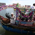 A woman dances on a boat as part of the Lagos Regatta in Lagos, Nigeria. Photo / AP