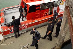 Navy personnel load their sonar equipment before leaving the wharf at Raglan. Photo / Alan Gibson