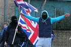 Loyalist protesters stage an angry demonstration with their Union flags in east Belfast. Photo / AFP