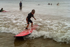 A surfing lesson demands every skerrick of a learner's attention - whatever their age. Photo / Supplied