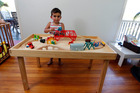 Young Dylan demonstrates how the table provides the ideal
