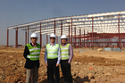 From left: Fred Wang, president of Formica Asia, Fletcher Buildings's Paul Zuckerman, and C.S. Heng, Jiujiang project manager, at the new plant last month. Photo / Supplied