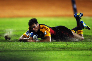 Richard Kahui of the Chiefs dives over to score a try during the match between the Chiefs and the Blues at Bay Park. Photo / Getty Images