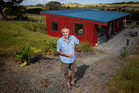 Eric Jansseune with his solar powered home. Eric is keen for New Zealand homes to use more solar energy and give back to the grid. Photo / Greg Bowker