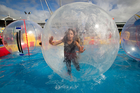 Aleesha Hickling, 9, enjoys the water fun at the Auckland Easter Show at the Showgrounds. Photo / Richard Robinson