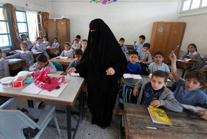 Palestinian children attend a class at the UNRWA elementary school in Shati refugee camp in Gaza City. Photo / AP