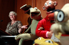 Jane Henson, left, with some of Jim Henson's earliest puppets, including the original Kermit. Photo / AP