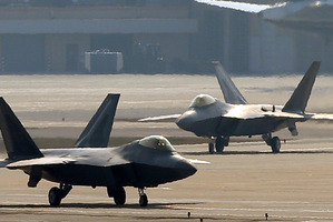 Two U.S. Air Force F-22 Raptor stealth fighter jets wait to take off during a military exercise at the Osan U.S. Air Base in Pyeongtaek, south of Seoul. Photo / AP