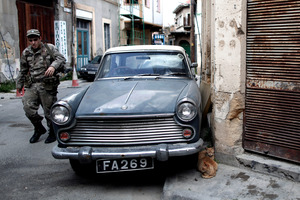 A Greek Cypriot soldier patrols the old town of the capital, Nicosia. Photo / AP