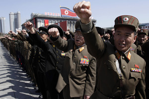 North Korean army officers punch the air as they chant slogans during a rally. Photo / AP