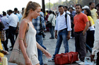 German tourist Carolina De Paola, 22, walks near the landmark Gateway of India in Mumbai, India. Photo / AP