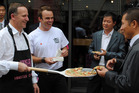 Prime Minister John Key cooks up a storm in Beijing with Gung Ho! Pizza's Jade Gray.