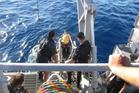 A Navy diver enters the water off the Kawhia coast. Photo / CAA